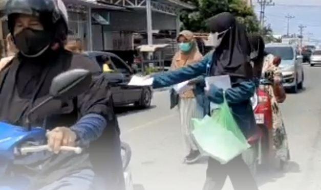 Pemuda di Touna Turun ke Jalan Bantu Sosialisasikan Vaksin